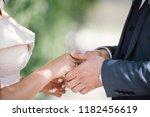 the bridegroom puts on the...   Shutterstock . vector #1182456619
