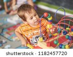 little asian child playing with ... | Shutterstock . vector #1182457720