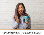 young indian woman surprised... | Shutterstock . vector #1182465100