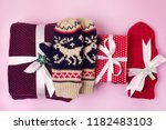 lilac hand knit scarf and red... | Shutterstock . vector #1182483103