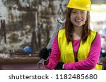 portrait of asian machinist in... | Shutterstock . vector #1182485680
