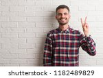 young adult man standing over... | Shutterstock . vector #1182489829