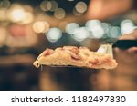 close up of hot pizza slice... | Shutterstock . vector #1182497830