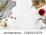 cup with a ready tea on a white ... | Shutterstock . vector #1182511570
