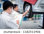 technicians perform vehicle... | Shutterstock . vector #1182511906