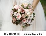 the bride is holding a wedding... | Shutterstock . vector #1182517363