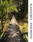 wooden suspension bridge in... | Shutterstock . vector #1182524476