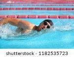 swimmer man athlete swimming in ... | Shutterstock . vector #1182535723