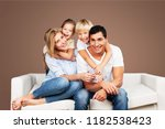 beautiful smiling family... | Shutterstock . vector #1182538423