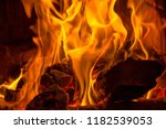 burning firewood and in flames... | Shutterstock . vector #1182539053