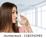 happy young woman drinking water | Shutterstock . vector #1182542983