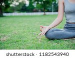 asian woman practices yoga and... | Shutterstock . vector #1182543940