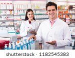 young team of a pharmaceutist... | Shutterstock . vector #1182545383