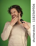 man with disheveled hair... | Shutterstock . vector #1182569506