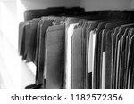 file folders on shelf for... | Shutterstock . vector #1182572356