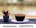 fresh coffee in clear glass...   Shutterstock . vector #1182595576