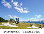 Young Asian couple looking at each other on high mountain, Schafberg mountain (the mountain in movie