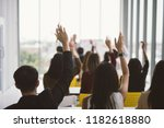 raised up hands and arms of... | Shutterstock . vector #1182618880