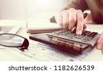human work on calculator... | Shutterstock . vector #1182626539