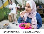 muslim girl with hijab eating... | Shutterstock . vector #1182628900