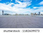 empty square with city skyline... | Shutterstock . vector #1182639073
