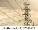 silhouette of high voltage... | Shutterstock . vector #1182644659
