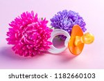 nipple and flowers on a pink... | Shutterstock . vector #1182660103