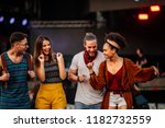 cropped shot of four friends... | Shutterstock . vector #1182732559