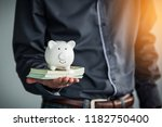 business holding money and...   Shutterstock . vector #1182750400