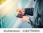 man holding passport in...   Shutterstock . vector #1182750403
