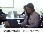 businesswoman typing message on ... | Shutterstock . vector #1182764290