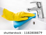 maid hand or charwoman cleaning ... | Shutterstock . vector #1182808879