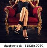 sensual woman on a red velvet... | Shutterstock . vector #1182860050