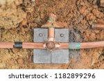 welding copper ground wire on... | Shutterstock . vector #1182899296