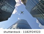 The Plane Flies Over High Rise...