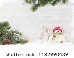 christmas snowman and sledge... | Shutterstock . vector #1182990439