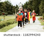 young kids trick or treating... | Shutterstock . vector #1182994243