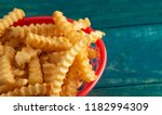 crinkle fries in a red cafe... | Shutterstock . vector #1182994309
