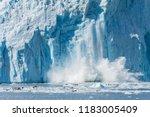 an actively calving glacier... | Shutterstock . vector #1183005409