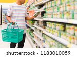 young man with basket at... | Shutterstock . vector #1183010059