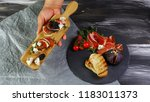 appetizers table with antipasti ... | Shutterstock . vector #1183011373