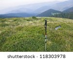 Small photo of Alpenstock with the background of Carpathian valley and mountains