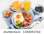 plate of breakfast with fried... | Shutterstock . vector #1183041763