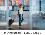 young woman with her luggage at ... | Shutterstock . vector #1183042693