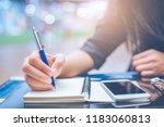 woman hand writing on a... | Shutterstock . vector #1183060813