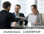 happy employers shake hand of... | Shutterstock . vector #1183089439