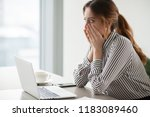 Small photo of Shocked woman worker looking at laptop screen surprised with bad or unexpected online news, amazed businesswoman feel despair rounding eyes witnessing company bankruptcy or market failure