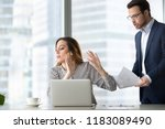 tired bothered businesswoman... | Shutterstock . vector #1183089490