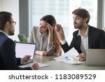 Small photo of Male colleagues argue having dispute at company briefing, woman worker stay calm and peaceful managing stress distracted form conflict, managers or partners disagree on terms at meeting