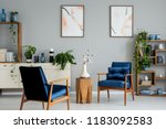 wooden table with flowers... | Shutterstock . vector #1183092583